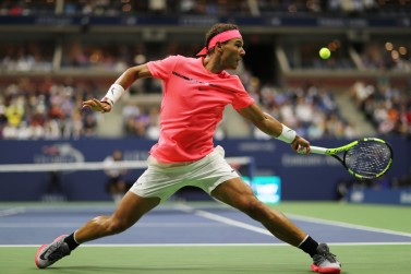 Rafael Nadal of Spain returns a shot to Dusan Lajovic of Serbia & Montenegro during their first round Men's Singles match on Day Two of the 2017 US Open at the USTA Billie Jean King National Tennis Center on August 29, 2017 in the Flushing neighborhood of the Queens borough of New York City. (Aug. 28, 2017 - Source: Elsa/Getty Images North America)