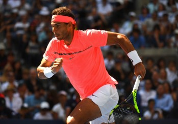 Rafael Nadal of Spain chases a ball while playing against Alexandr Dolgopolov of Ukraine during their Round 4, US Open 2017, Men's Singles match at the USTA Billie Jean King National Tennis Center on September 4, 2017, in New York. / AFP PHOTO / TIMOTHY A. CLARY
