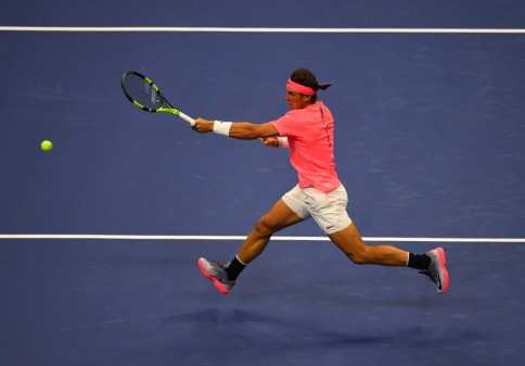 Spain's Rafael Nadal returns the ball to Russia's Andrey Rublev during their 2017 US Open Men's Singles Quarterfinal match at the USTA Billie Jean King National Tennis Center in New York on September 6, 2017. / AFP PHOTO / TIMOTHY A. CLARY