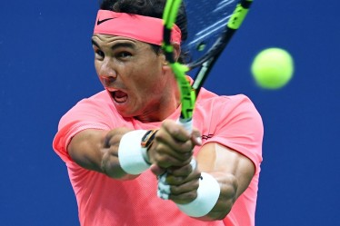 Spain's Rafael Nadal returns the ball to Russia's Andrey Rublev during their 2017 US Open Men's Singles Quarterfinal match at the USTA Billie Jean King National Tennis Center in New York on September 6, 2017. / AFP PHOTO / Jewel SAMAD