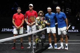 Jack Sock and Sam Querrey of Team World and Roger Federer and Rafael Nadal line up with Anna Wintour ahead of there doubles match against Roger Federer and Rafael Nadal of Team Europe on Day 2 of the Laver Cup on September 23, 2017 in Prague, Czech Republic. The Laver Cup consists of six European players competing against their counterparts from the rest of the World. Europe will be captained by Bjorn Borg and John McEnroe will captain the Rest of the World team. The event runs from 22-24 September. (Sept. 22, 2017 - Source: Julian Finney/Getty Images Europe)
