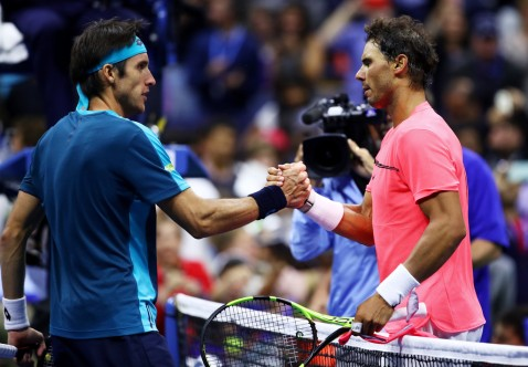 Rafael Nadal of Spain (R) shakes hands with Leonardo Mayer of Argentina after defeating him in their third round match on Day Six of the 2017 US Open at the USTA Billie Jean King National Tennis Center on September 2, 2017 in the Flushing neighborhood of the Queens borough of New York City. (Sept. 1, 2017 - Source: Clive Brunskill/Getty Images North America)