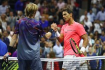 Andrey Rublev of Russia shakes hands with Rafael Nadal of Spain after Nadal won their Men's Singles Quarterfinal match on Day Ten of the 2017 US Open at the USTA Billie Jean King National Tennis Center on September 6, 2017 in the Flushing neighborhood of the Queens borough of New York City. (Sept. 5, 2017 - Source: Al Bello/Getty Images North America)