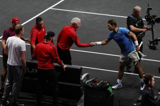 John Mcenroe of Team World shakes hands with Rafael Nadal of Team Europe after his mens singles match against John Isner of Team World on the final day of the Laver cup on September 24, 2017 in Prague, Czech Republic. The Laver Cup consists of six European players competing against their counterparts from the rest of the World. Europe will be captained by Bjorn Borg and John McEnroe will captain the Rest of the World team. The event runs from 22-24 September. (Sept. 23, 2017 - Source: Julian Finney/Getty Images Europe)
