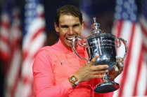 Rafael Nadal of Spain bites the championship trophy during the trophy ceremony after their Men's Singles Finals match on Day Fourteen of the 2017 US Open at the USTA Billie Jean King National Tennis Center on September 10, 2017 in the Flushing neighborhood of the Queens borough of New York City. Rafael Nadal defeated Kevin Anderson in the third set with a score of 6-3, 6-3, 6-4. (Sept. 9, 2017 - Source: Clive Brunskill/Getty Images North America)