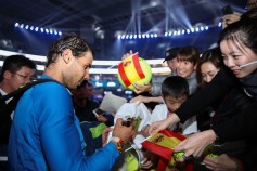 Rafael Nadal of Spain sign to the fans after winning the Men's Singles final against Nick Kyrgios of Australia on day nine of the 2017 China Open at the China National Tennis Centre on October 8, 2017 in Beijing, China. (Oct. 7, 2017 - Source: Lintao Zhang/Getty Images AsiaPac)