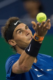 Rafael Nadal of Spain serves during his men's 2nd round singles match against Jared Donaldson of the US at the Shanghai Masters tennis tournament in Shanghai on October 11, 2017. / AFP PHOTO / NICOLAS ASFOURI (Oct. 10, 2017 - Source: AFP)