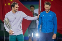 Winner Roger Federer of Switzerland (L) and second-placed Rafael Nadal of Spain react as they hold their trophies after the men's singles final match at the Shanghai Masters tennis tournament in Shanghai on October 15, 2017. / AFP PHOTO / Nicolas ASFOURI (Photo credit should read NICOLAS ASFOURI/AFP/Getty Images)