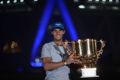 Rafael Nadal of Spain hold the winners trophy poses for a picture after winning the Men's Singles final against Nick Kyrgios of Australia on day nine of the 2017 China Open at the China National Tennis Centre on October 8, 2017 in Beijing, China. (Oct. 7, 2017 - Source: Lintao Zhang/Getty Images AsiaPac)