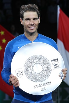 Rafael Nadal of Spain poses with the runner-up trophy after the Men's singles final match against Roger Federer of Switzerland on day eight of 2017 ATP Shanghai Rolex Masters at Qizhong Stadium on October 15, 2017 in Shanghai, China. (Oct. 14, 2017 - Source: Lintao Zhang/Getty Images AsiaPac)