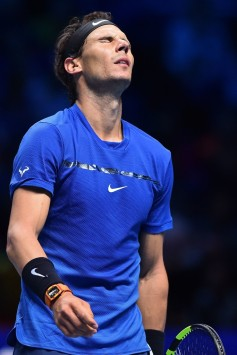 Spain's Rafael Nadal reacts during his singles match against Belgium's David Goffin on day two of the ATP World Tour Finals tennis tournament at the O2 Arena in London on November 13, 2017. / AFP PHOTO / Glyn KIRK