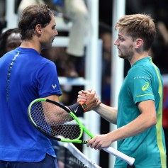 Belgium's David Goffin (R) shakes hands with Spain's Rafael Nadal (L) after winning their singles match on day two of the ATP World Tour Finals tennis tournament at the O2 Arena in London on November 13, 2017. / AFP PHOTO / Glyn KIRK