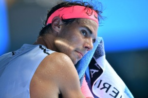 Spain's Rafael Nadal uses a towel during their men's singles fourth round match against Argentina's Diego Schwartzman on day seven of the Australian Open tennis tournament in Melbourne on January 21, 2018. / AFP PHOTO / SAEED KHAN / -- IMAGE RESTRICTED TO EDITORIAL USE - STRICTLY NO COMMERCIAL USE -- (Photo credit should read SAEED KHAN/AFP/Getty Images)
