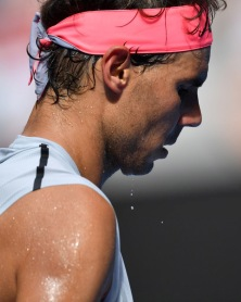 Perspiration drips from Spain's Rafael Nadal during their men's singles fourth round match against Argentina's Diego Schwartzman on day seven of the Australian Open tennis tournament in Melbourne on January 21, 2018. / AFP PHOTO / SAEED KHAN / -- IMAGE RESTRICTED TO EDITORIAL USE - STRICTLY NO COMMERCIAL USE -- (Photo credit should read SAEED KHAN/AFP/Getty Images)