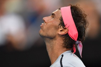 Spain's Rafael Nadal reacts after a point against Argentina's Diego Schwartzman during their men's singles fourth round match on day seven of the Australian Open tennis tournament in Melbourne on January 21, 2018. / AFP PHOTO / SAEED KHAN / -- IMAGE RESTRICTED TO EDITORIAL USE - STRICTLY NO COMMERCIAL USE -- (Photo credit should read SAEED KHAN/AFP/Getty Images)