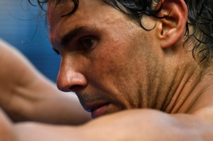 Spain's Rafael Nadal reacts during their men's singles fourth round match against Argentina's Diego Schwartzman on day seven of the Australian Open tennis tournament in Melbourne on January 21, 2018. / AFP PHOTO / SAEED KHAN / -- IMAGE RESTRICTED TO EDITORIAL USE - STRICTLY NO COMMERCIAL USE -- (Photo credit should read SAEED KHAN/AFP/Getty Images)