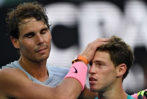 Spain's Rafael Nadal (L) gestures to Argentina's Diego Schwartzman after their men's singles fourth round match on day seven of the Australian Open tennis tournament in Melbourne on January 21, 2018. / AFP PHOTO / SAEED KHAN / -- IMAGE RESTRICTED TO EDITORIAL USE - STRICTLY NO COMMERCIAL USE -- (Photo credit should read SAEED KHAN/AFP/Getty Images)