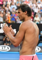 Spain's Rafael Nadal celebrates after their men's singles fourth round match against Argentina's Diego Schwartzman on day seven of the Australian Open tennis tournament in Melbourne on January 21, 2018. / AFP PHOTO / SAEED KHAN / -- IMAGE RESTRICTED TO EDITORIAL USE - STRICTLY NO COMMERCIAL USE -- (Photo credit should read SAEED KHAN/AFP/Getty Images)