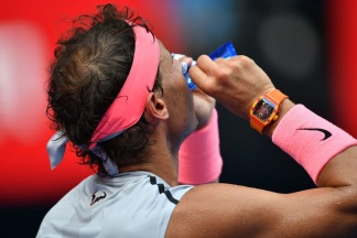 Spain's Rafael Nadal is seen during their men's singles fourth round match against Argentina's Diego Schwartzman on day seven of the Australian Open tennis tournament in Melbourne on January 21, 2018. / AFP PHOTO / SAEED KHAN / -- IMAGE RESTRICTED TO EDITORIAL USE - STRICTLY NO COMMERCIAL USE -- (Photo credit should read SAEED KHAN/AFP/Getty Images)
