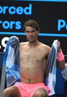 Spain's Rafael Nadal uses a towel during their men's singles fourth round match against Argentina's Diego Schwartzman on day seven of the Australian Open tennis tournament in Melbourne on January 21, 2018. / AFP PHOTO / WILLIAM WEST / -- IMAGE RESTRICTED TO EDITORIAL USE - STRICTLY NO COMMERCIAL USE -- (Photo credit should read WILLIAM WEST/AFP/Getty Images)