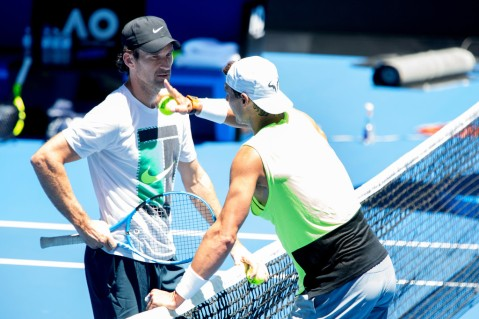 Rafael Nadal of Spain talks to coach Carlos Moya during a training session ahead of the Australian Open Grand Slam at Rod Laver Arena on January 5, 2018 in Melbourne, Australia. (Jan. 4, 2018 - Source: Fiona Hamilton/Getty Images AsiaPac)