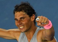 Spain's Rafael Nadal celebrates beating Bosnia's Damir Dzumhur in their men's singles third round match on day five of the Australian Open tennis tournament in Melbourne on January 19, 2018. / AFP PHOTO / Greg Wood / -- IMAGE RESTRICTED TO EDITORIAL USE - STRICTLY NO COMMERCIAL USE -- (Photo credit should read GREG WOOD/AFP/Getty Images)