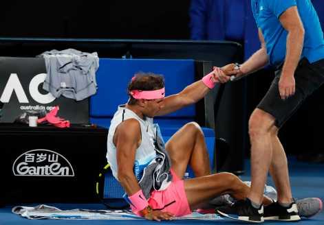 Tennis - Australian Open - Quarterfinals - Rod Laver Arena, Melbourne, Australia, January 23, 2018. Spain's Rafael Nadal receives medical attention during his match against Croatia's Marin Cilic. REUTERS/Issei Kato
