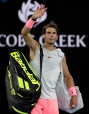 Spain's Rafael Nadal waves as he leaves Rod Laver Arena after withdrawing injured in his quarterfinal against Croatia's Marin Cilic at the Australian Open tennis championships in Melbourne, Australia, Tuesday, Jan. 23, 2018. (AP Photo/Dita Alangkara)
