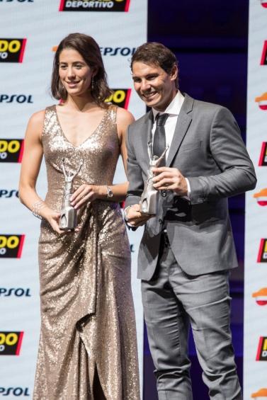 BARCELONA, SPAIN - FEBRUARY 05: Garbiñe Muguruza and Rafael Nadal receive the best sportwoman and sportman of the year award during the 70th Mundo Deportivo Gala on February 5, 2018 in Barcelona, Spain. (Photo by Xavi Torrent/Getty Images)