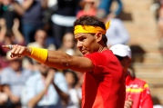 Spain's Rafael Nadal points during his match against Germany's Alexander Zverev during a World Group Quarter final Davis Cup tennis match between Spain and Germany at the bullring in Valencia, Spain, Sunday April 8, 2018. (AP Photo/Alberto Saiz)