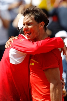 Spain's Rafael Nadal celebrates with Spain's captain Sergi Bruguera after defeating Germany's Alexander Zverev 6-1, 6-4, 6-4 during a World Group Quarter final Davis Cup tennis match between Spain and Germany at the bullring in Valencia, Spain, Sunday April 8, 2018. (AP Photo/Alberto Saiz)