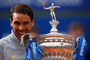 Spain's Rafael Nadal poses with his trophy after winning the Barcelona Open Tennis Tournament final in Barcelona, Spain, Sunday, April 29, 2018. Nadal defeated Greece's Stefanos Tsitsipas 6-2, 6-1 in the final. (AP Photo/Manu Fernandez)