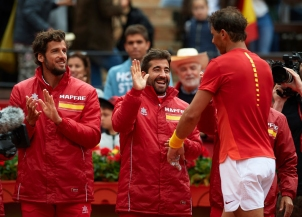 VALENCIA, SPAIN - APRIL 06: Rafael Nadal of Spain celebrates with his teammates following his victory against Philipp Kohlschreiber of Germany during day one of the Davis Cup World Group Quarter Final match between Spain and Germany at Plaza de Toros de Valencia on April 6, 2018 in Valencia, Spain. (Photo by Manuel Queimadelos Alonso/Getty Images)