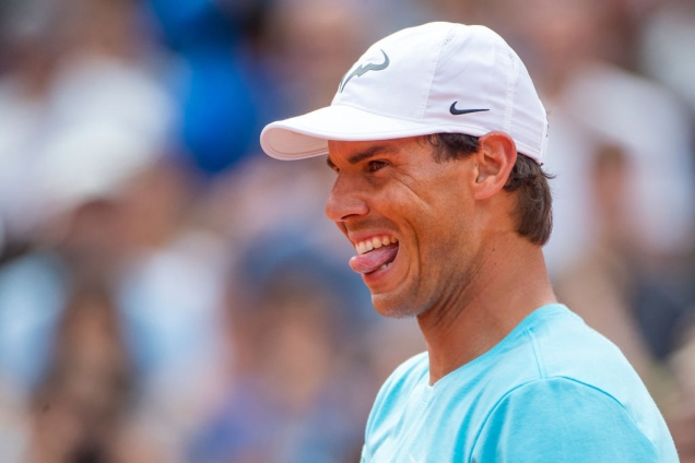 2018 French Open Tennis Tournament - Rafael Nadal of Spain reacts while playing with Novak Djokovic of Serbia in a tie break doubles exhibition match against Simone Halep of Romania and Alexander Zverev of Germany on Court Philippe Chatrier during a packed Children's Day at Roland Garros before the start of the 2018 French Open Tennis Tournament at Roland Garros on May 26th 2018 in Paris, France. (Photo by Tim Clayton/Corbis via Getty Images)