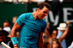 Spain's Rafael Nadal celebrates after victory over Italy's Simone Bolelli during their men's singles first round match on day three of The Roland Garros 2018 French Open tennis tournament in Paris on May 29, 2018. (Photo by CHRISTOPHE SIMON / AFP) (Photo credit should read CHRISTOPHE SIMON/AFP/Getty Images)
