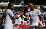 Lucas Pouille of France shakes hands at the net after beating Rafael Nadal of Spain 2 - 0 during the Aspall Tennis Classic at Hurlingham on June 29, 2018 in London, England. (Photo by Justin Setterfield/Getty Images)