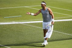 epa06846894 Rafael Nadal of Spain removes a pole during a training session at the All England Lawn Tennis Championships in Wimbledon, London, 28 June 2018. The Wimbledon Tennis Championships 2018 will be held in London from 02 July to 15 July. EPA-EFE/PETER KLAUNZER EDITORIAL USE ONLY/NO SALES/NO ARCHIVES