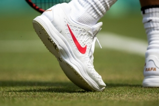 A detail of Rafael Nadal's shoes during play against Mikhail Kukushkin KAZ in the second round of the Gentlemen's Singles on Centre Court. The Championships 2018. Held at The All England Lawn Tennis Club, Wimbledon. Day 4 Thursday 05/07/2018. Credit: AELTC/Jed Leicester