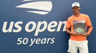 August 24, 2018 - Rafael Nadal poses with the US Open 50 Years of Championship book at the 2018 US Open. USTA/Mike Lawrence