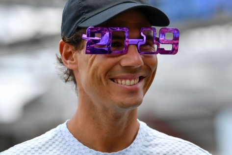 Rafael Nadal of Spain wears festive new year 2019 eyewear in front of the Queensland Tennis centre in Brisbane on December 31, 2018, during the Brisbane International tennis tournament. (Photo by Saeed Khan / AFP) / -- IMAGE RESTRICTED TO EDITORIAL USE - STRICTLY NO COMMERCIAL USE -- (Photo credit should read SAEED KHAN/AFP/Getty Images)