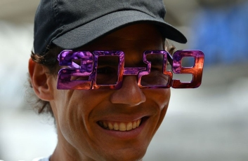 Rafael Nadal of Spain wears festive new year 2019 eyewear during a media call in front of the Queensland Tennis centre in Brisbane on December 31, 2018, during the Brisbane International tennis tournament. (Photo by Saeed Khan / AFP) / -- IMAGE RESTRICTED TO EDITORIAL USE - STRICTLY NO COMMERCIAL USE -- (Photo credit should read SAEED KHAN/AFP/Getty Images)