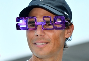 Rafael Nadal of Spain wears 2019 novelty glasses during day one of the Brisbane International tennis tournament at the Queensland Tennis Centre in Brisbane, Australia, 31 December 2018. EPA-EFE/ EDITORIAL USE ONLY AUSTRALIA AND NEW ZEALAND OUT, Image: 404799197, License: Rights-managed, Restrictions: EDITORIAL USE ONLY AUSTRALIA AND NEW ZEALAND OUT, Model Release: no, Credit line: Profimedia, TEMP EPA
