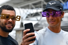 Rafael Nadal of Spain (R) poses for a selfie with France's Jo-Wilfried Tsonga while wearing festive new year 2019 eyewear in front of the Queensland Tennis centre in Brisbane on December 31, 2018, during the Brisbane International tennis tournament. (Photo by Saeed Khan / AFP) / -- IMAGE RESTRICTED TO EDITORIAL USE - STRICTLY NO COMMERCIAL USE -- (Photo credit should read SAEED KHAN/AFP/Getty Images)