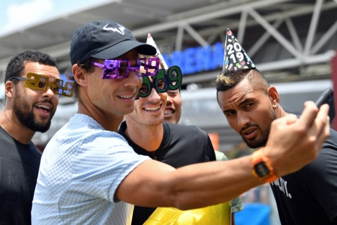 Rafael Nadal of Spain (2nd L) poses for a selfie with France's Jo-Wilfried Tsonga (L), Andy Murray of Britain (C), Kei Nishikori of Japan (2nd R) and Nick Kyrgios of Australia (R) while wearing festive new year 2019 eyewear and party hats in front of the Queensland Tennis centre in Brisbane on December 31, 2018, at the Brisbane of International tennis tournament. (Photo by Saeed Khan / AFP) / -- IMAGE RESTRICTED TO EDITORIAL USE - STRICTLY NO COMMERCIAL USE -- (Photo credit should read SAEED KHAN/AFP/Getty Images)