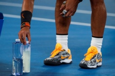 Spain's Rafael Nadal adjusts his drink bottles during a break as he plays against Frances Tiafoe of the US in their men's singles quarter-final match on day nine of the Australian Open tennis tournament in Melbourne on January 22, 2019. (Photo by DAVID GRAY / AFP) / -- IMAGE RESTRICTED TO EDITORIAL USE - STRICTLY NO COMMERCIAL USE -- (Photo credit should read DAVID GRAY/AFP/Getty Images)