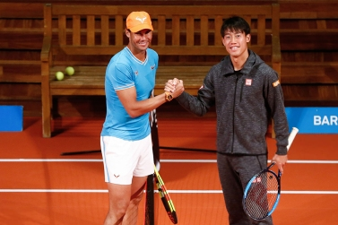 Spain's Rafael Nadal (L) shakes hands with Japan's Kei Nishikori at the Palau de la Musica in Barcelona on April 22, 2019 on the sidelines of the Barcelona ATP Open tennis tournament. (Photo by PAU BARRENA / AFP) (Photo credit should read PAU BARRENA/AFP/Getty Images)