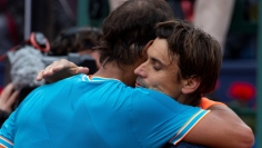 Spanish tennis player Rafa Nadal (L) embraces fellow countryman David Ferrer (R) after his victory in their third round men's single match at the 67th Barcelona Open tennis tournament, in Barcelona, Spain, Apr. 25, 2019. EPA-EFE/Enric Fontcuberta