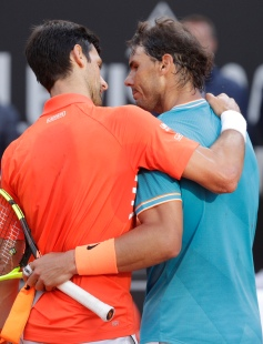 Rafael Nadal, right, of Spain embraces Novak Djokovic of Serbia at the end of their final match at the Italian Open tennis tournament, in Rome, Sunday, May 19, 2019. (AP Photo/Gregorio Borgia)