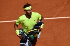 Spain's Rafael Nadal holds towels during his men's singles second round match against Germany's Yannick Maden on day four of The Roland Garros 2019 French Open tennis tournament in Paris on May 29, 2019. (Photo by Philippe LOPEZ / AFP) (Photo credit should read PHILIPPE LOPEZ/AFP/Getty Images)