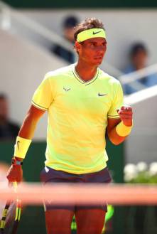 PARIS, FRANCE - JUNE 07: Rafael Nadal of Spain celebrates during his mens singles semi-final match against Roger Federer of Switzerland during Day thirteen of the 2019 French Open at Roland Garros on June 07, 2019 in Paris, France. (Photo by Clive Brunskill/Getty Images)